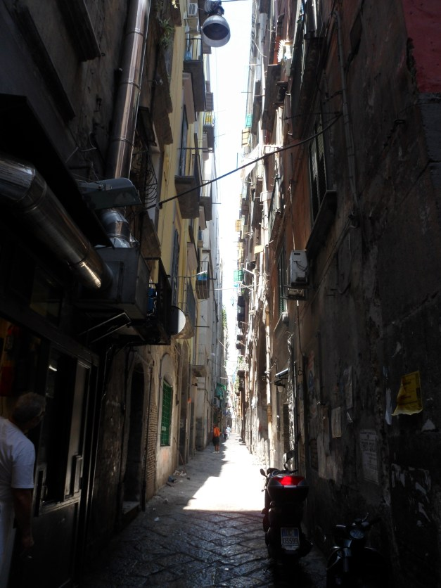 One of hundreds of tiny, narrow streets. I've read - though I haven't seen it yet - that there are one-way pedestrian ways in Naples.