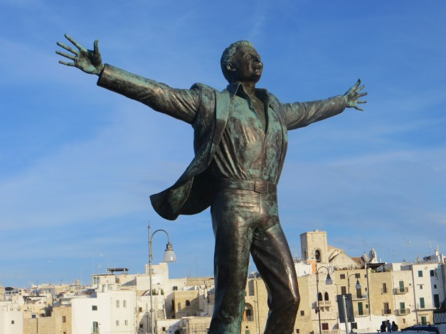 "Our final stop was in the town Polignano a Mare. This happy statue is Domenico Modugno. You may not have heard of him, but you have most definitely heard him - he recorded the iconic 1950s Italian song ""Volare"". Even I knew who he was, i just loved the exuberance; he just looks so happy!"