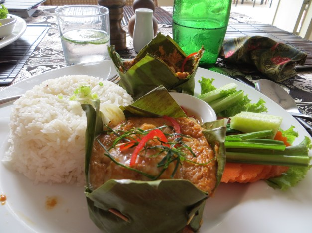 """The food has been great. One or the other of us had this dish - fish amok, fish in a spicy peanut sauce, served in a banana leaf """"bowl"""" - every day at lunch. Dinners were around $24 total, including wine!"""