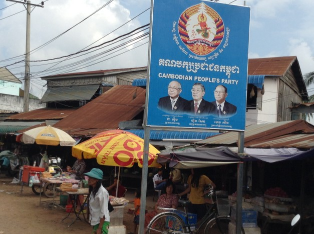 """SIgns for the Cambodia People's Party were everywhere - as in easily five or more per kilometer as we drove towards Battambang. We're going to suggest to the DNC that they do the same. Maybe if there were signs that said """"Democratic Party"""" with pictures of Barack Obama and Joe Biden every 200 yards or so along highways the Tea Party would love them. Right?"""