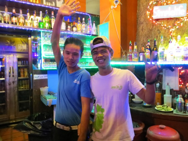 Our happy bartenders at Simple Life. They make a great Johnny Walker on the rocks!