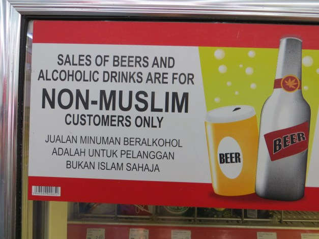 Malaysia is a Moslem country, and a lot of places neither serve nor sell liquor. This place found a reasonable solution - I can buy it, but the locals can't.