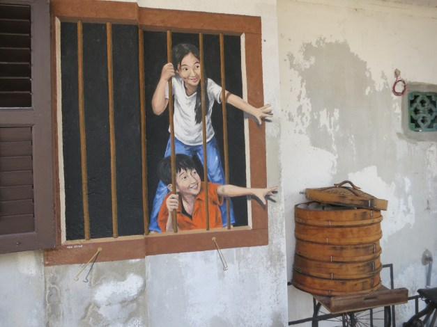 One of the most remarkable aspects of George Town (the city we're staying in, on the island of Penang) is the murals painted on exterior walls. Some of them - like this one - are really beautiful.