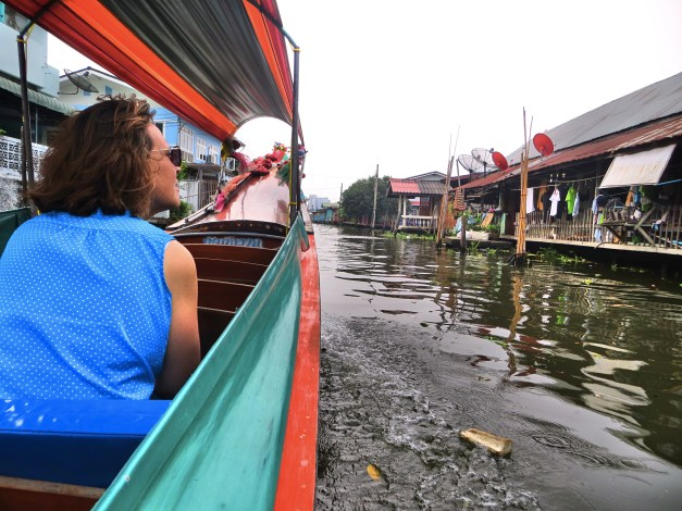 Moving up through one of the canals. Houses and businesses all along the waterway, people going about their lives.