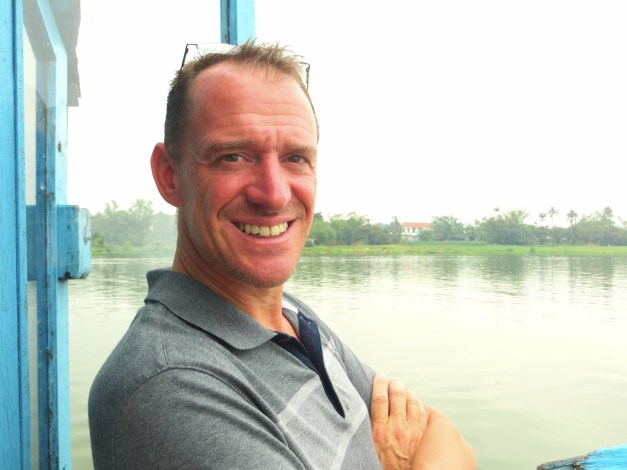 Mark enjoying the boat ride down the Perfume River