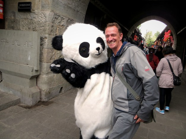 Sìchuan is known for its giant pandas. Here we see Mark running into one in the old town.