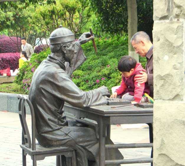 I love this shot of a kid playing with the abacus that's part of a statue. Oddly, the wise old guy in the statue looked strikingly like Morgan Freeman….