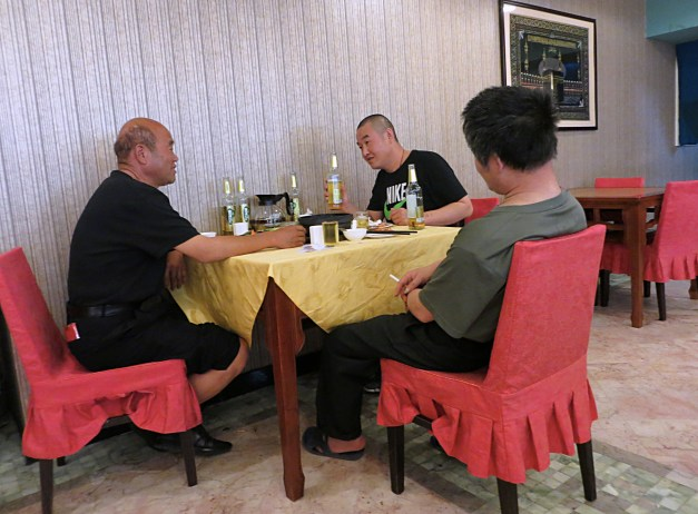 The downside of Chinese restaurants can be your neighbors. You can see on this table next to us multiple beer bottles, fueling a stunningly loud conversation, particularly the guy with his back to us. Notice also the cigarette in his hand. There were No Smoking signs in the restaurant, but apparently they didn't work very well.