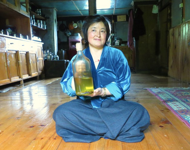 Here's our cook, after clearing the table/floor, showing off her homemade wheat wine. Her grandfather used to cook for the king and she still uses some of the same recipes.