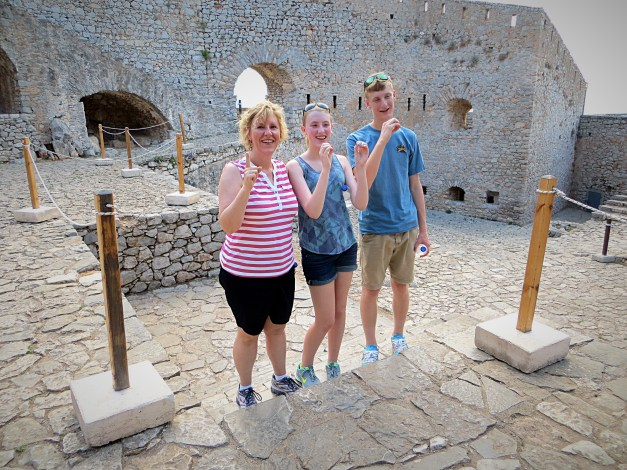Laura, Elizabeth, and Charlie signal the 1,000th step on the way up the Palamidi Fortress