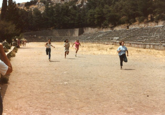 Today, the stadium is roped off; you can see it but you can't go into it. When Mark was here in 1984, though, it was wide open and so some of the girls he was traveling with sponsored their own version of the Pythian games. He had all the fun!