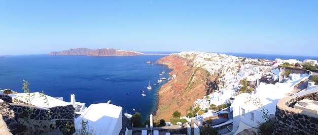 A panoramic view of the town of Oia on the north end of Santorini from our hotel. With the island of Therasia forming the other edge of the caldera, the water is stunning, the cliffs are breathtaking, and the white buildings seem to melt down the side of the island.