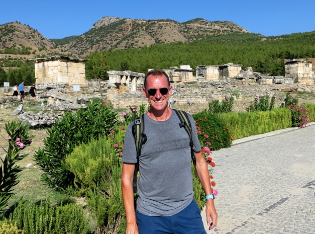 Mark, on the entry to the tour through the ruins. That hedge behind him was rosemary, enough to last you a lifetime.