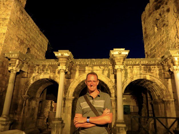 Mark in front of the first century Gate of Hadrian, still providing an entry into the old city