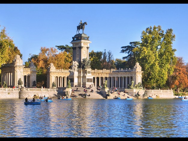 A grand monument to Alfonso XII in Buen Retiro Park on a beautiful day