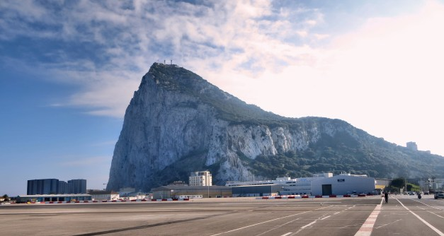 The Rock of Gibraltar. After you pass through British passport control you actually walk across the airport runway - that's the big flat paved area - to get into the city.