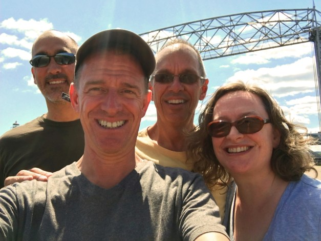 My brother Al, Mark, me, and Mark's sister Jeanne, with Duluth's iconic Aerial Lift Bridge behind us