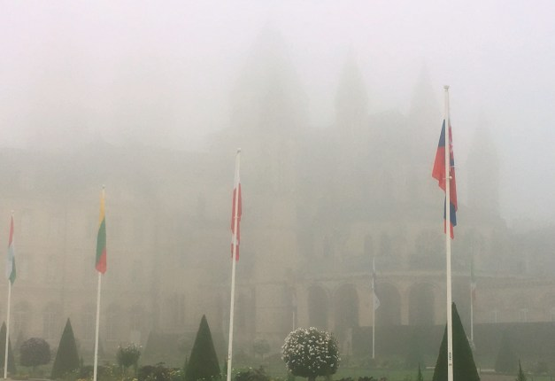The fog-covered St. Stephen's Church, where William the Conqueror is buried