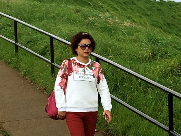 "It's not uncommon to see Asians wearing shirts with slogans in English that don't really make a lot of sense. We loved this woman's sweater up on Mt. Eden: ""Let's Shopping O'Clock."" We're guessing that's a bad translation of ""It's Shopping Time,"" but either way it's pretty funny."