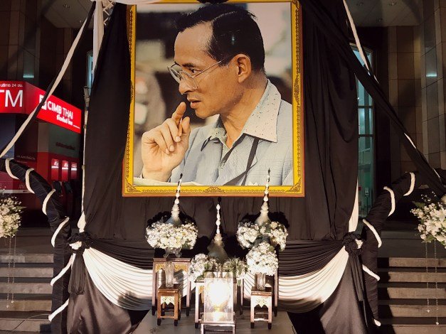 "King Rama IX died on October 13, 2016, after over 70 years on the throne; I suspect he used to refer to Elizabeth as ""that new queen."" They are still in official mourning for him with pictures and bunting and memorials to him everywhere."