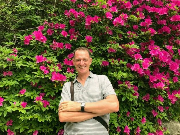 Mark in front of azaleas in Kochi