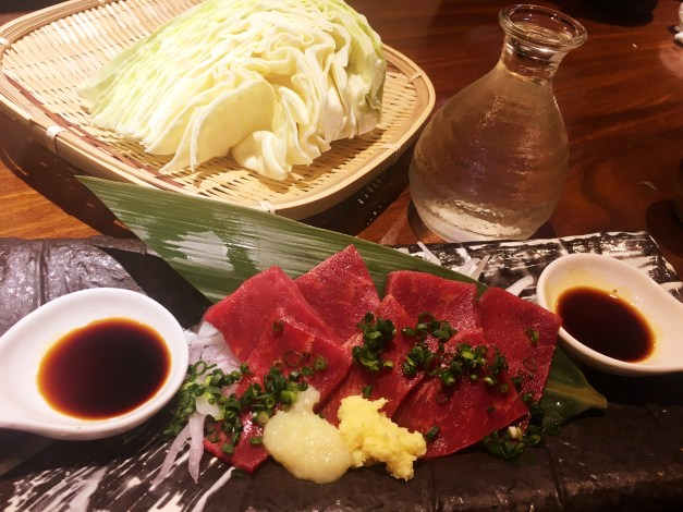 Mark posted this picture on Facebook, just in the comments section of the pictures from Tokyo I put up, and it generated quite a conversation. This, you see, is horse sashimi, or raw horse meat. As you might guess, there was quite a discussion about eating ... raw horse? Yes, we ate it and yes, it was delicious.