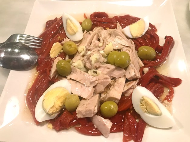 We both love the simple foods of Spain, in this case a salad of roasted peppers with canned tuna, olives, and eggs all nicely dressed with vinegar and olive oil