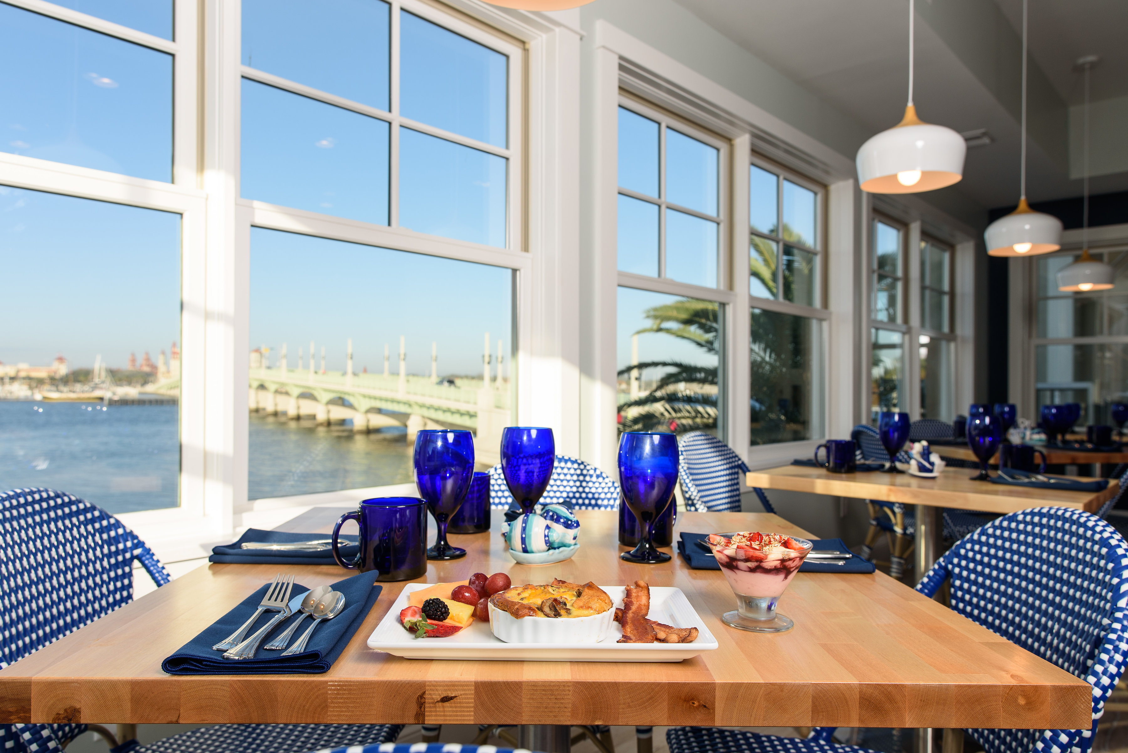 Breakfast table in captains table with view of bay int the background