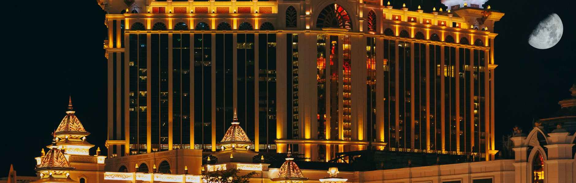 exterior of modern luxury hotel complex at night