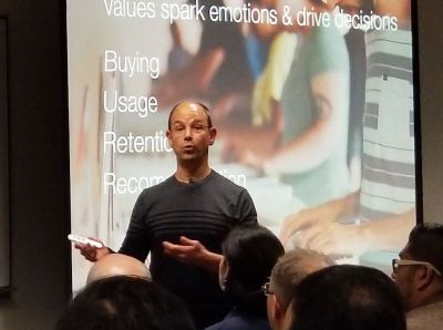 Photo of Alan Albert presenting about customer values