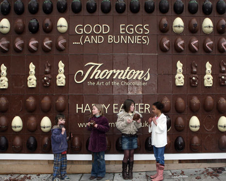 LONDON - APRIL 03:  Kim, Megan, Ellen and Kitty eat chocolate from the World's First Edible Billboard on April 3, 2007 in Covent Garden, London. Thorntons will kick-off Easter celebrations by inviting shoppers and passers-by to break off and eat chunks of chocolate from giant chocolate Easter eggs and bunnies (Photo by Matt Cardy/Getty Images) *** Local Caption *** Kim;Megan;Ellen;Kitty
