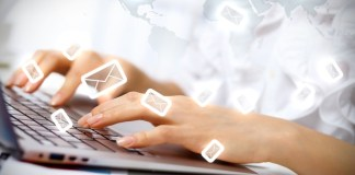 girl typing on laptop envelop symbols