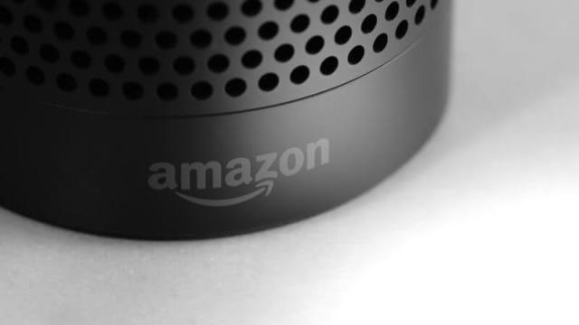 The base of Amazon . com Echo, the smart speaker home associated with voice agent Alexa