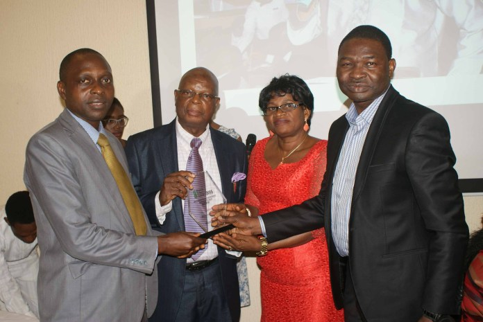 Dr. Josiah Ebhomenye of Market Trends receives award from Mr. Feyisola, MD, Media Stamp