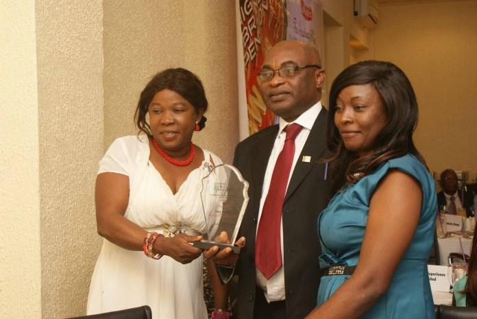 Mr, Yinka Adepoju of OYSAA and his team displays platinum award