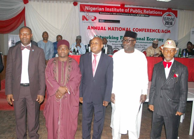 New Fellows of the Nigerian Institute of Public Relations: L-R; Mr Basil Agboarumi, Professor Samaila Mande, Rev Abraham Olusola-Niyi, Mr Festus Akande and Mr Benedict Olufemi Ajayi during their induction as Fellows at the NIPR 2016 AGM in Ibadan.