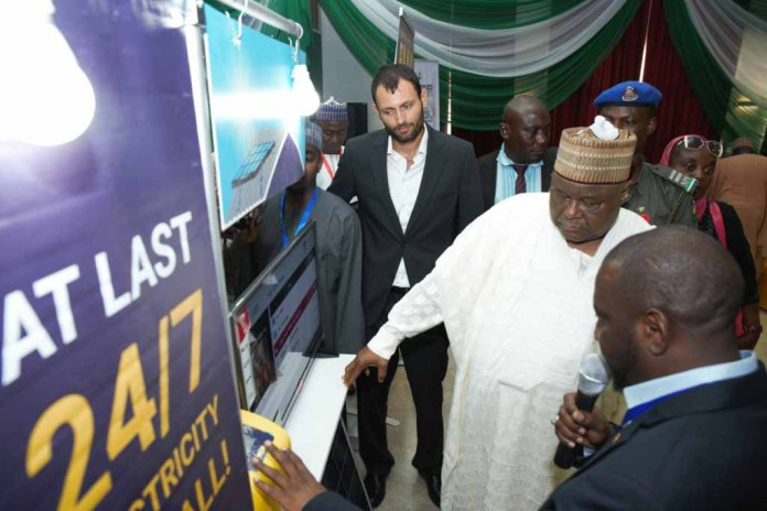 pix shows: Deputy Governor of Kastina State, Alhaji Munir Yakubu inspecting the MTN Mobile electricity device during the Kastina State Economic and Investment Summit