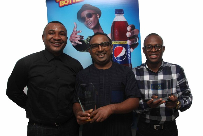 L-R: Account Director, Insight Communications, Jones Bassey, Head Marketing, Seven-Up Bottling Company Plc, Norden Thurston, and Brand Manager, Seven-Up Bottling Company Plc, Segun Ogunleye displaying the OAAN's Overall Grand PRIX Award won by Pepsi Long throat campaign.