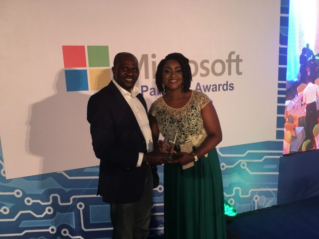 L-R: Managing Director, Reliance Infosystem, Olayemi Popoola; and SMS&P Group Director, Microsoft Nigeria, Wemimo Adeniyi, at the recently held Partners' awards in Lagos.