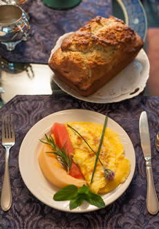 Egg quiche with watermelon, cantaloupe and a loaf of bread