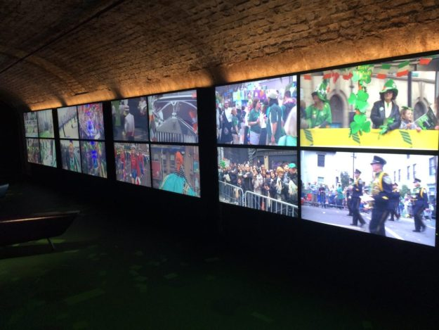 Video screens inside EPIC Ireland show images of St. Patrick's Day parades around the world.