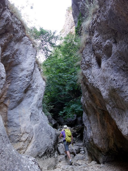 Squeezing between rocks in the Celano Gorge