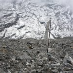 A single prayer flag flutters among the wasteland of old Langtang