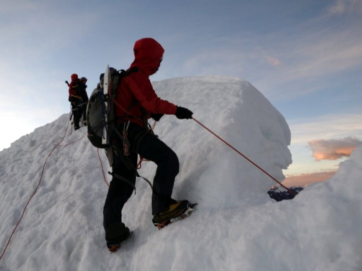 Pasang belays through Ishinca's summit cornice