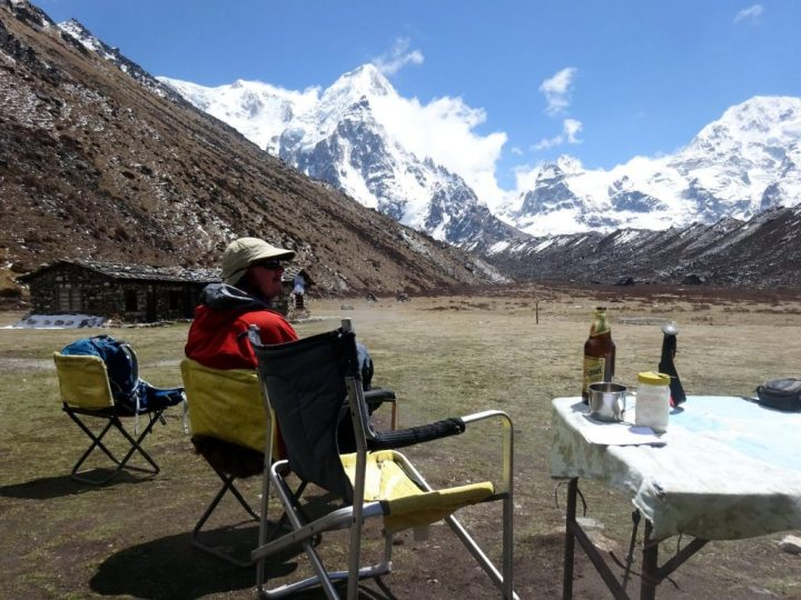 Enjoying a beer at Ramche, with Kabru and the peaks of the Indian border rising above