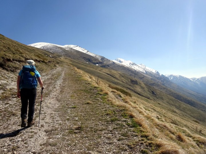 The broad, gentle track beneath Monte Ienca, with a snow-clad Pizzo di Camarda up ahead