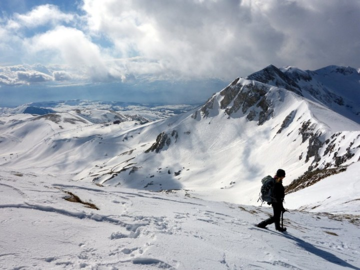 Descending from Monte Aquila with Campo Imperatore below