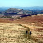 Walkers on Matterdale Common, with Great Mell Fell ahead