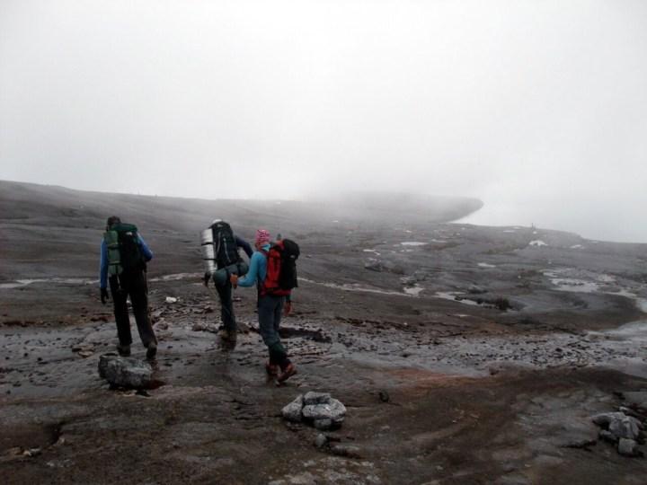 Eerie mist and bare rock slabs