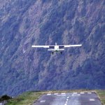 Twin Otter plane flying out of Lukla